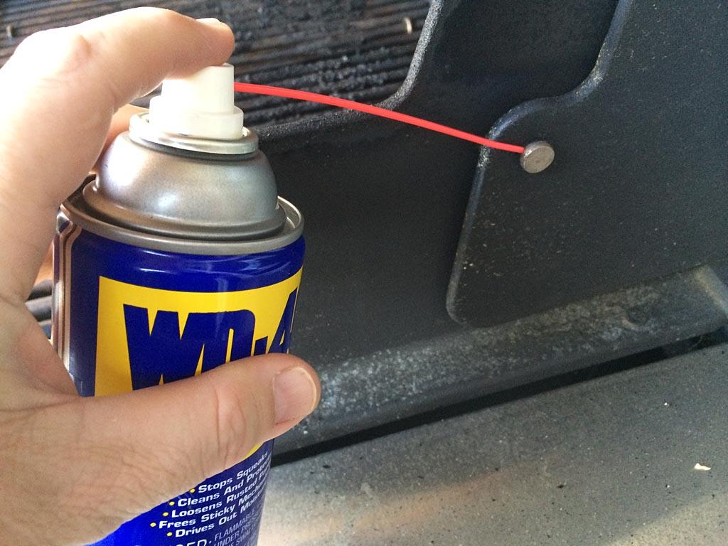 Lubricating a squeaky lid hinge
