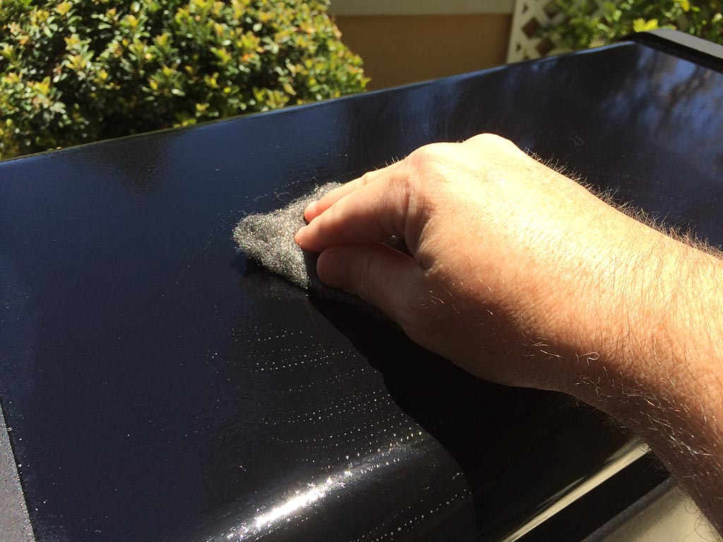Gently scrubbing surface with 0000 steel wool and Simple Green