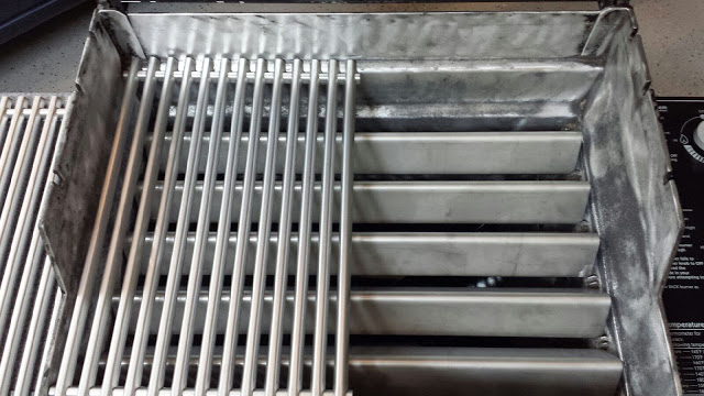New stainless steel grill grates complete the restoration.