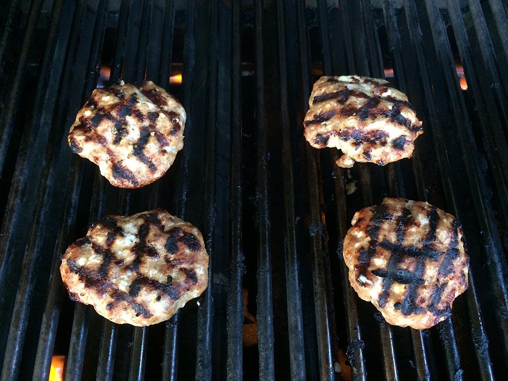 Grilling the pork patties
