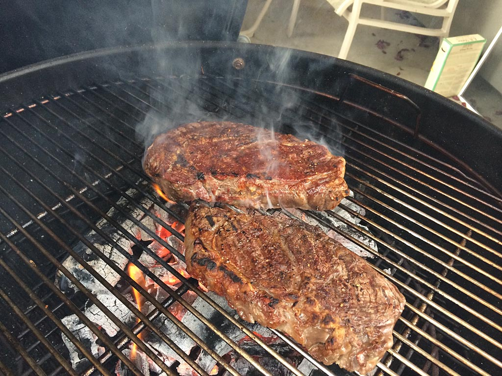 Steaks flipped and searing on the second side