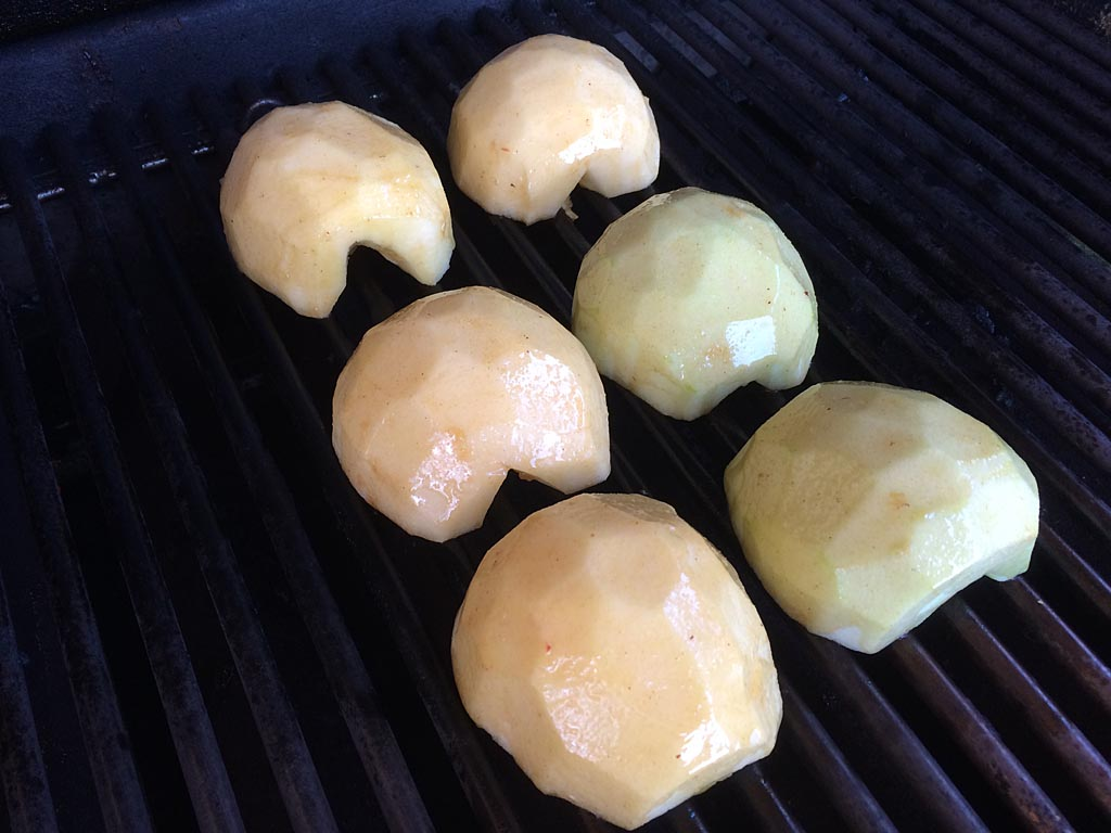 Apples cut-side down on the grill