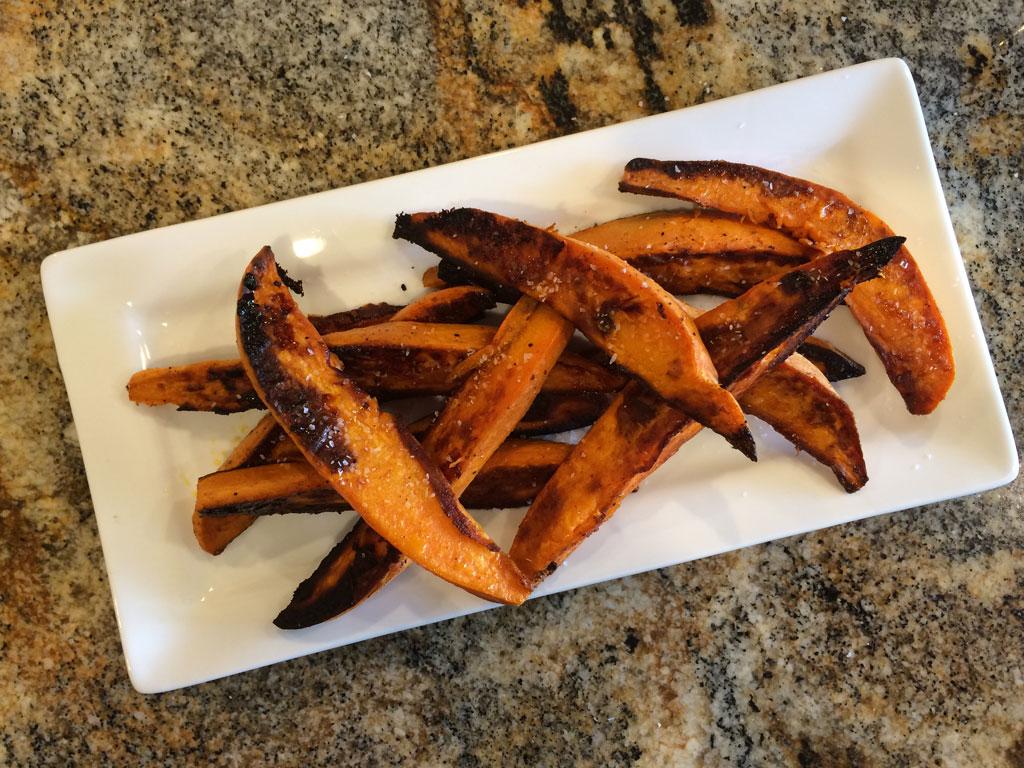 Finished sweet potato wedges sprinkled with kosher salt