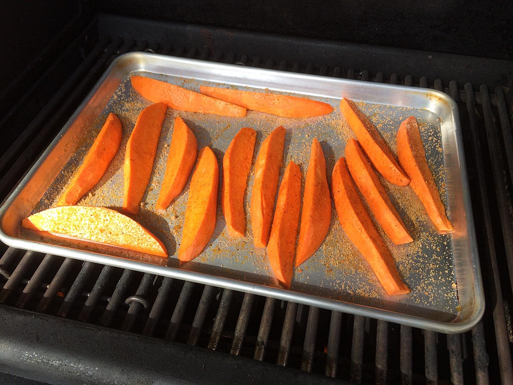 Sweet potato wedges go into Weber Summit gas grill