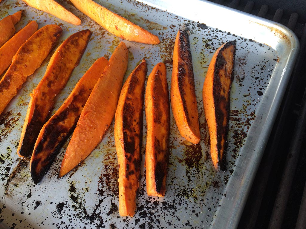 Grilled sweet potato wedges with charred surface