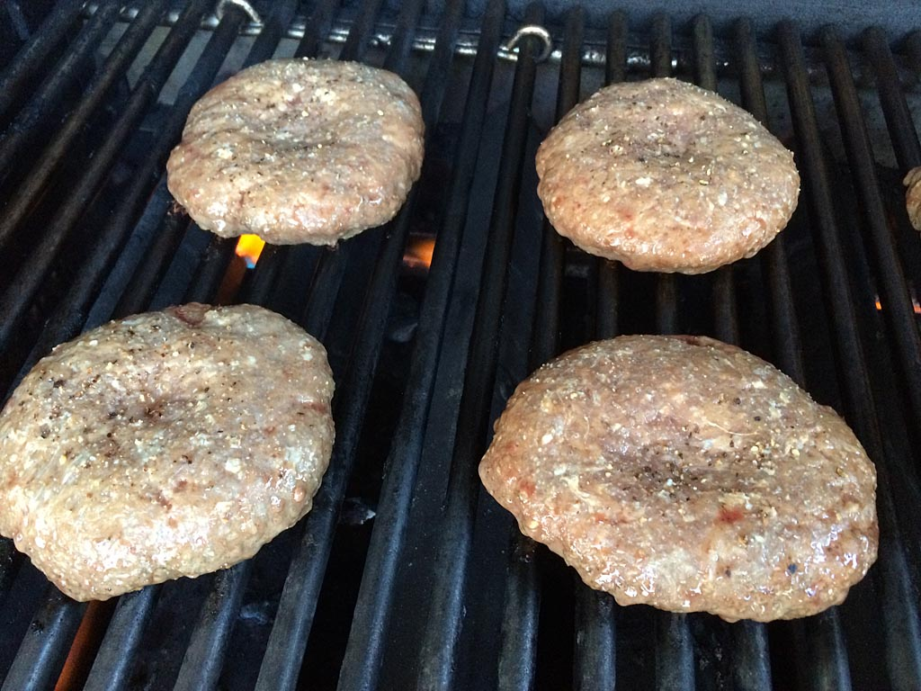 Pressed burgers on the grill