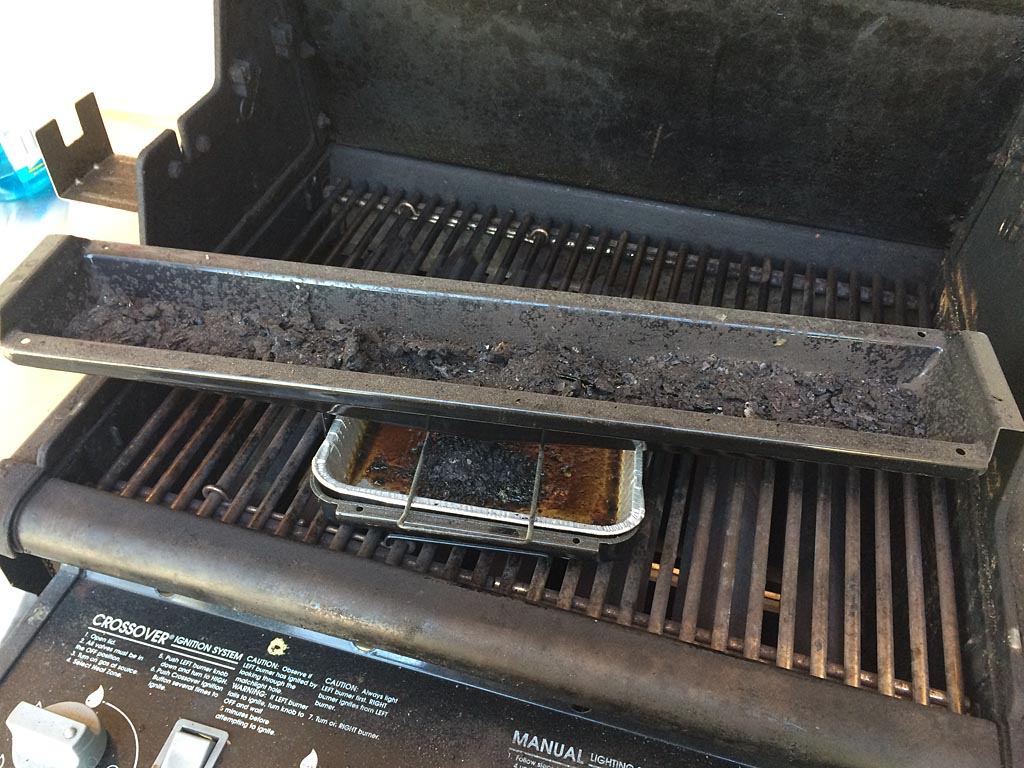 Dirty bottom tray and drip pan