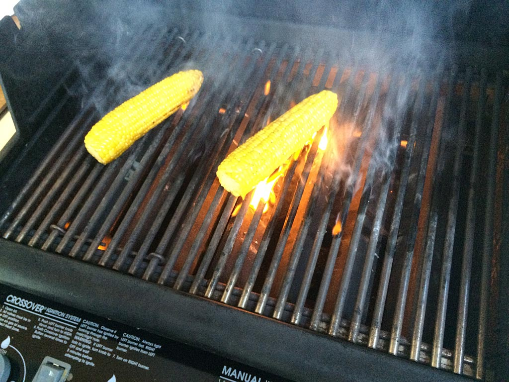 Corn flaring-up on the grill