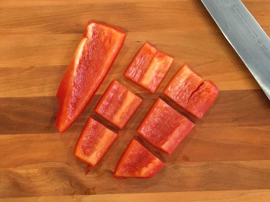 Cutting bell pepper into pieces