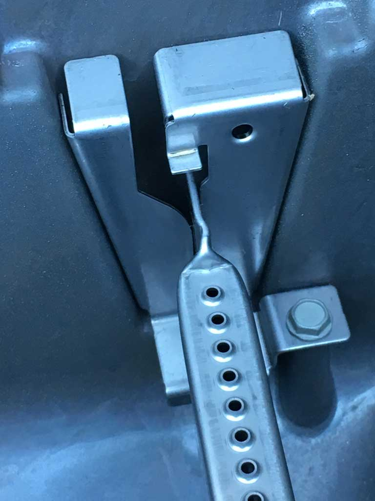 The back end of each burner snaps into a bracket.
