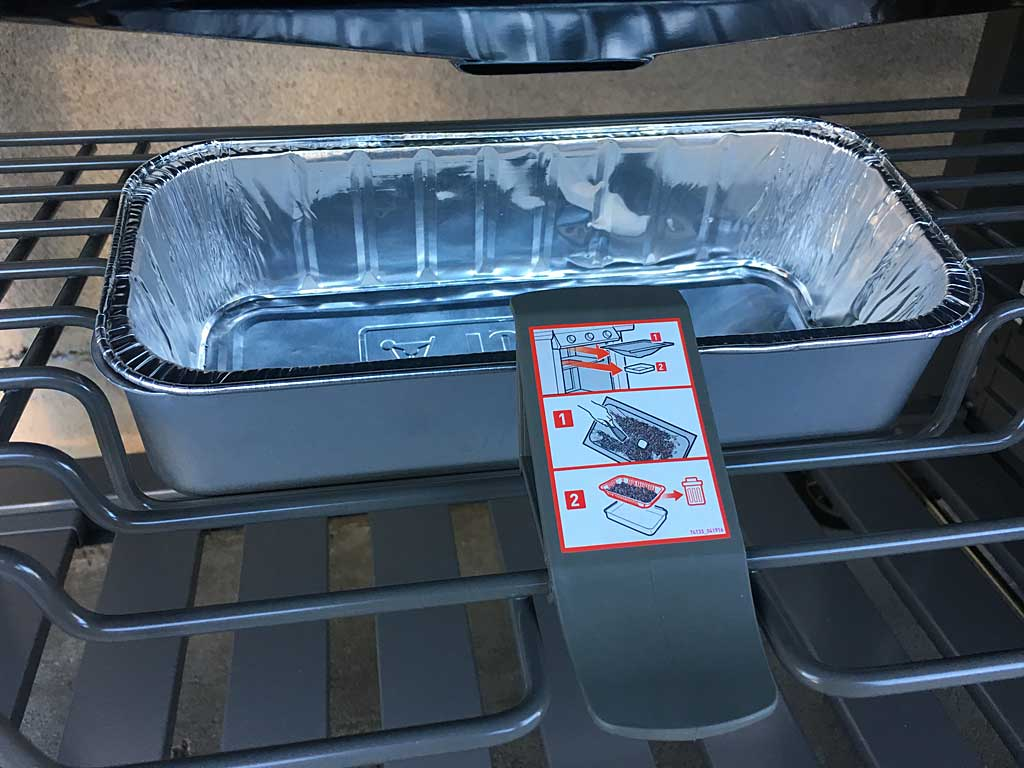 The drip pan has a plastic latch that holds it in place.