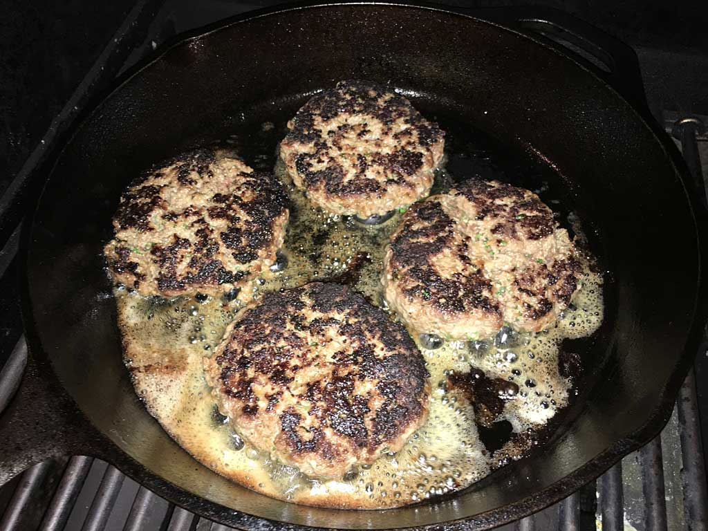 Searing burgers on the second side
