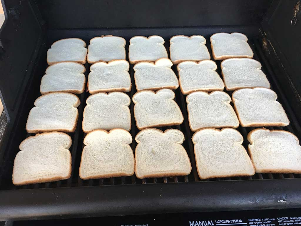 Bread arranged on cooking grate
