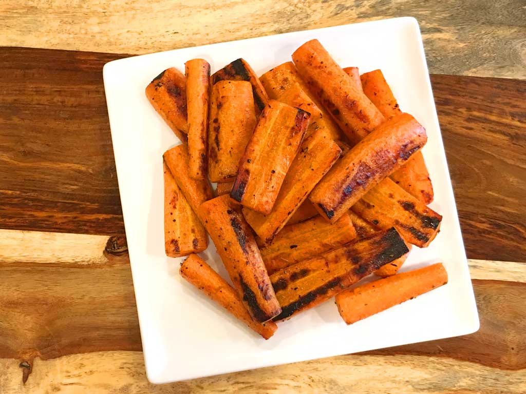 Grilled carrots on serving plate