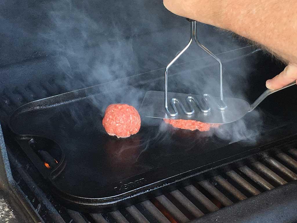 Smashing a burger
