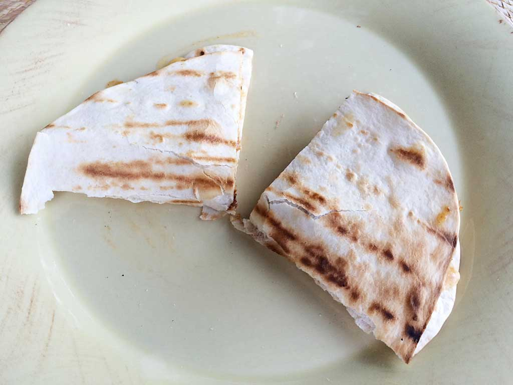 Chicken quesadillas cut in half