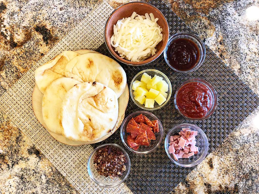 Individual naan and pizza ingredients