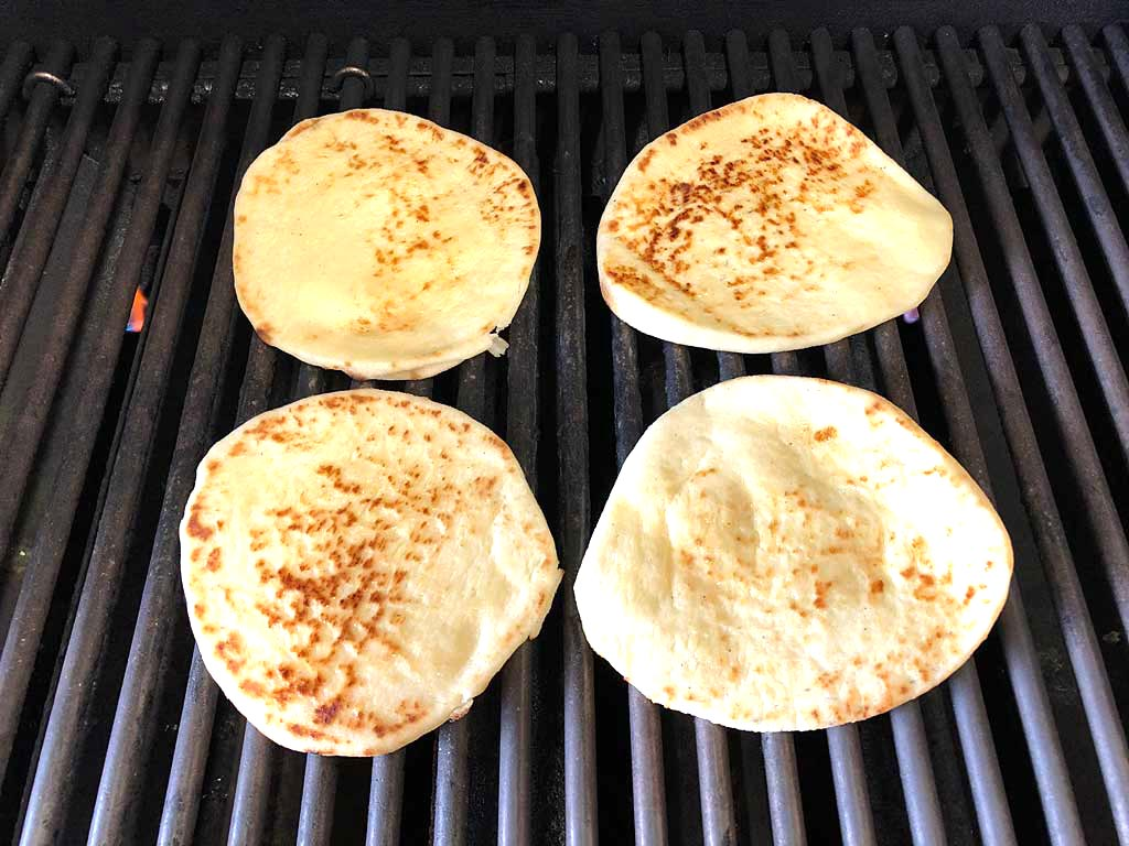 Naan goes into the gas grill