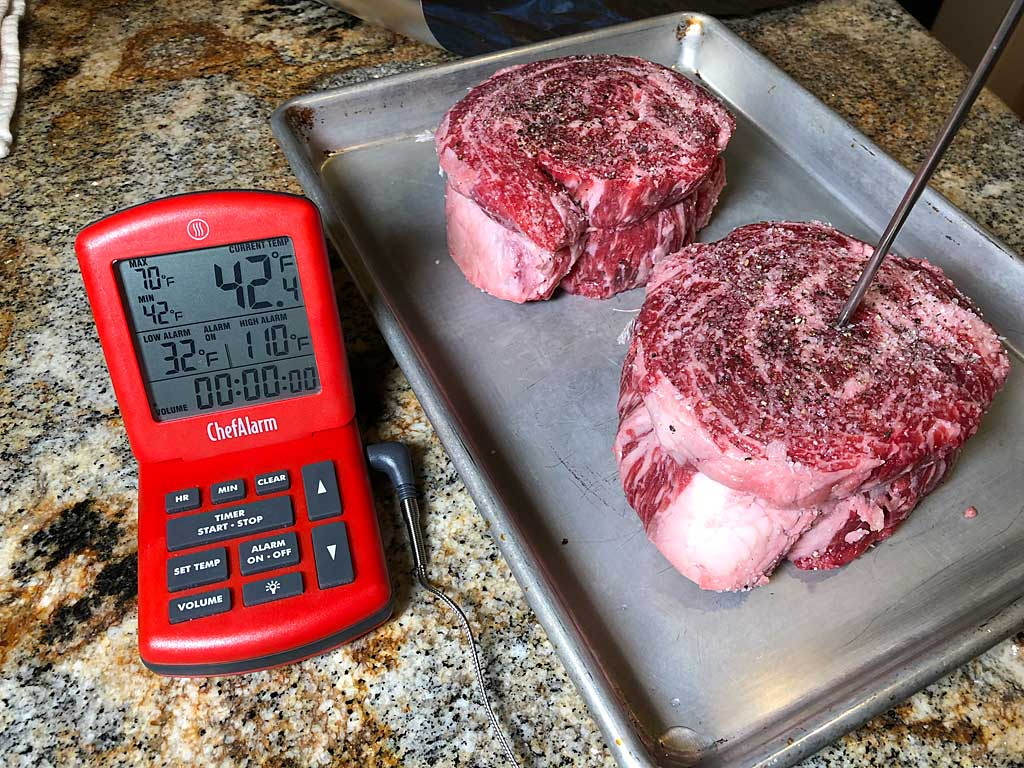 Two ribeye cap steaks with ThermoWorks ChefAlarm probe thermometer