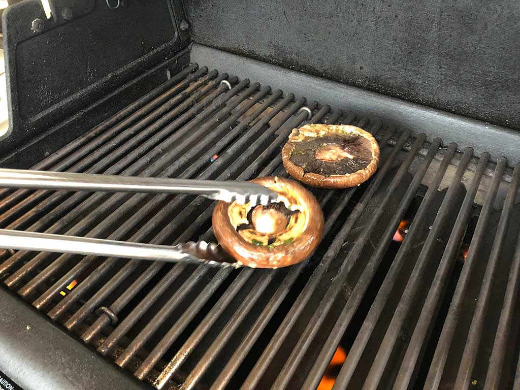 Mushrooms go into the gas grill
