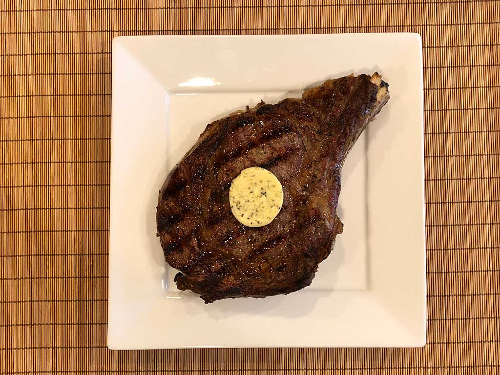 Compound butter on grilled steak