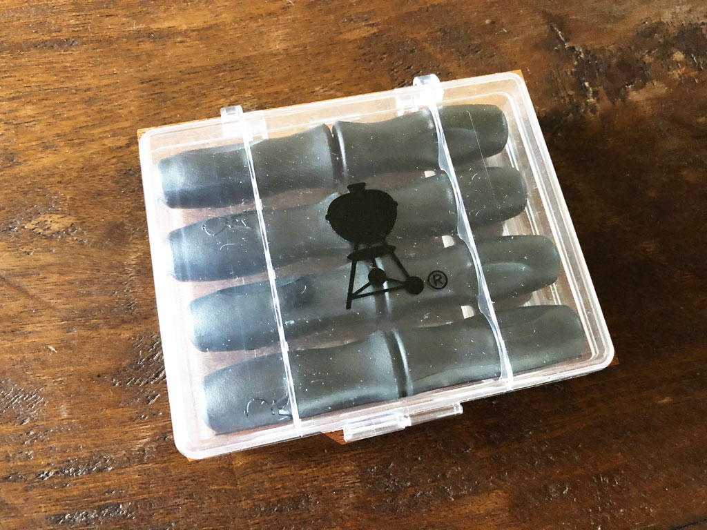 Clear plastic storage box with Weber kettle silhouette