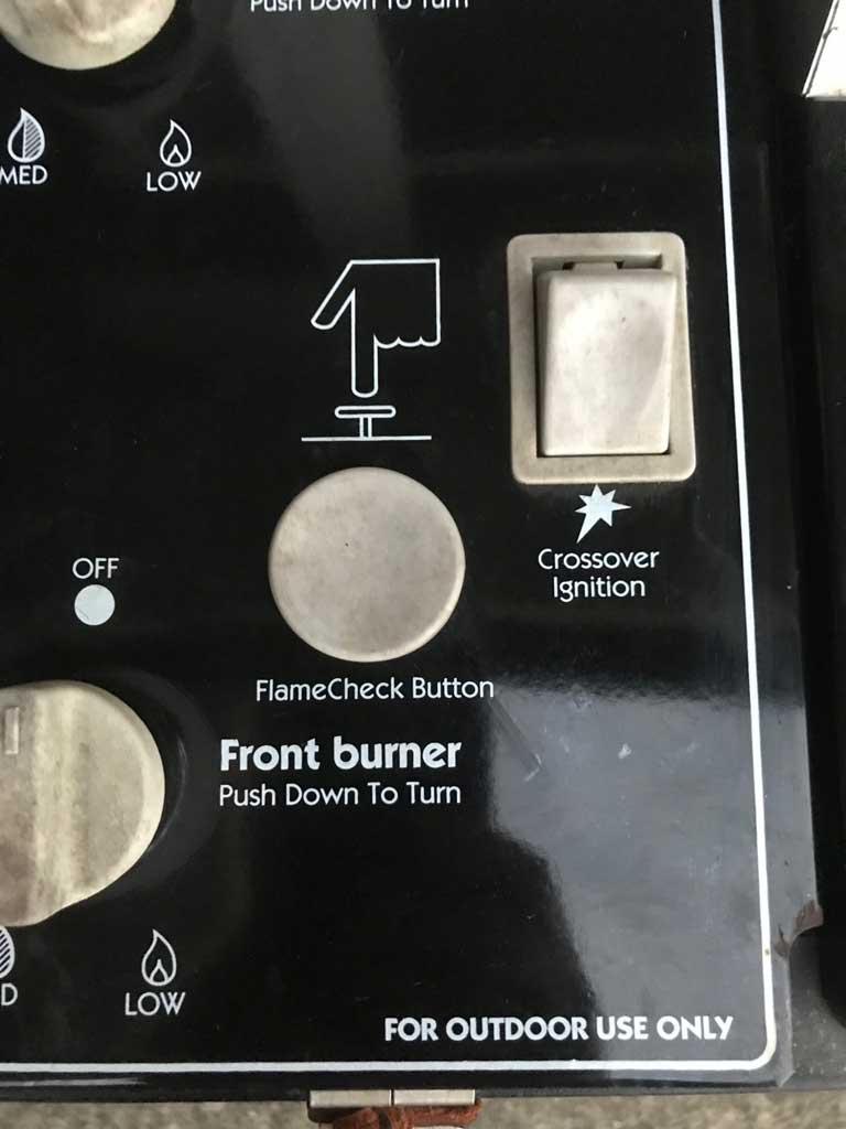 The FlameCheck Safety System button