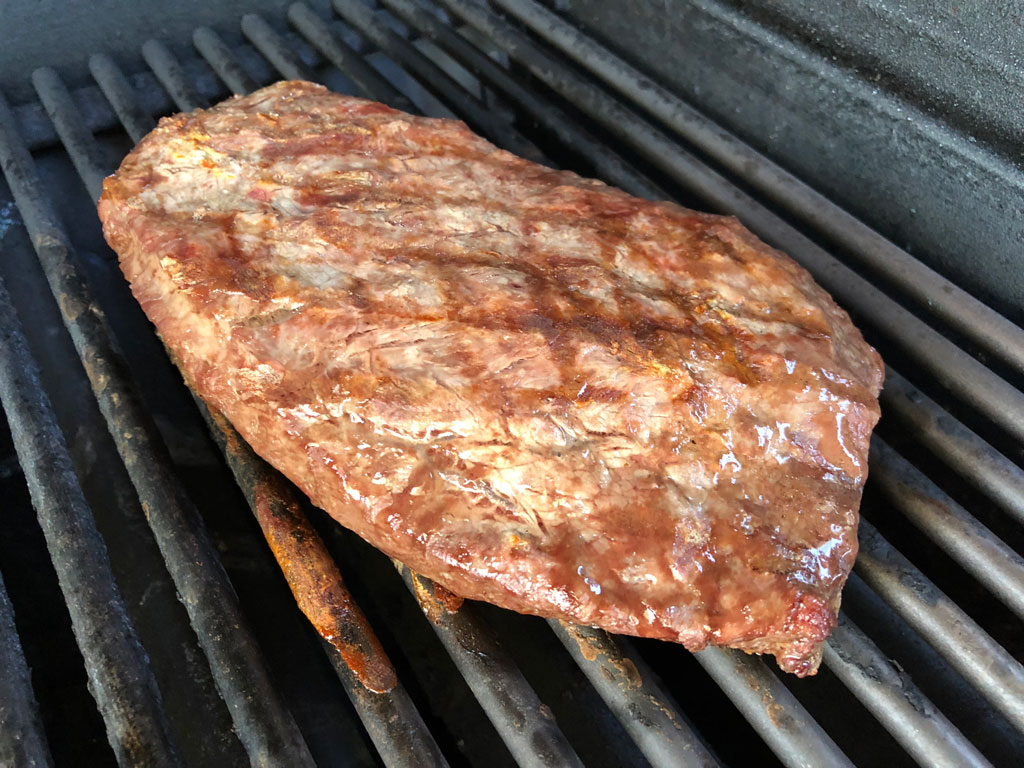 Pale looking flat iron steak after 8 minutes grilling