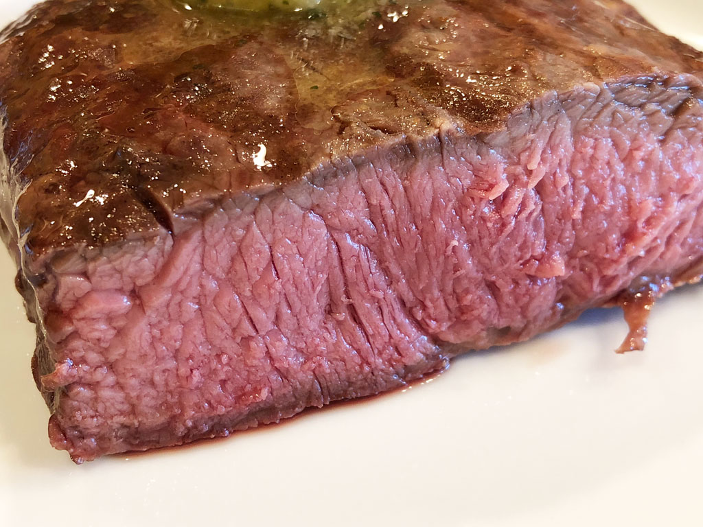 Close-up interior view of perfectly cooked flat iron steak
