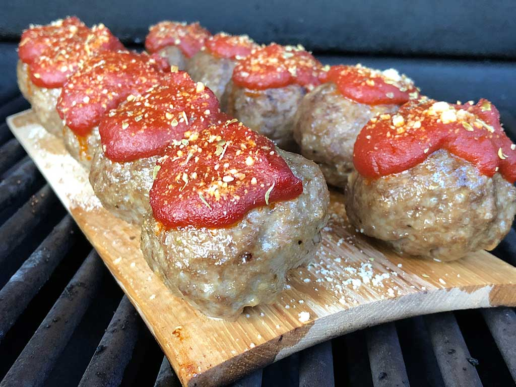 Hickory planed meatballs with marinara sauce and Parmesan cheese