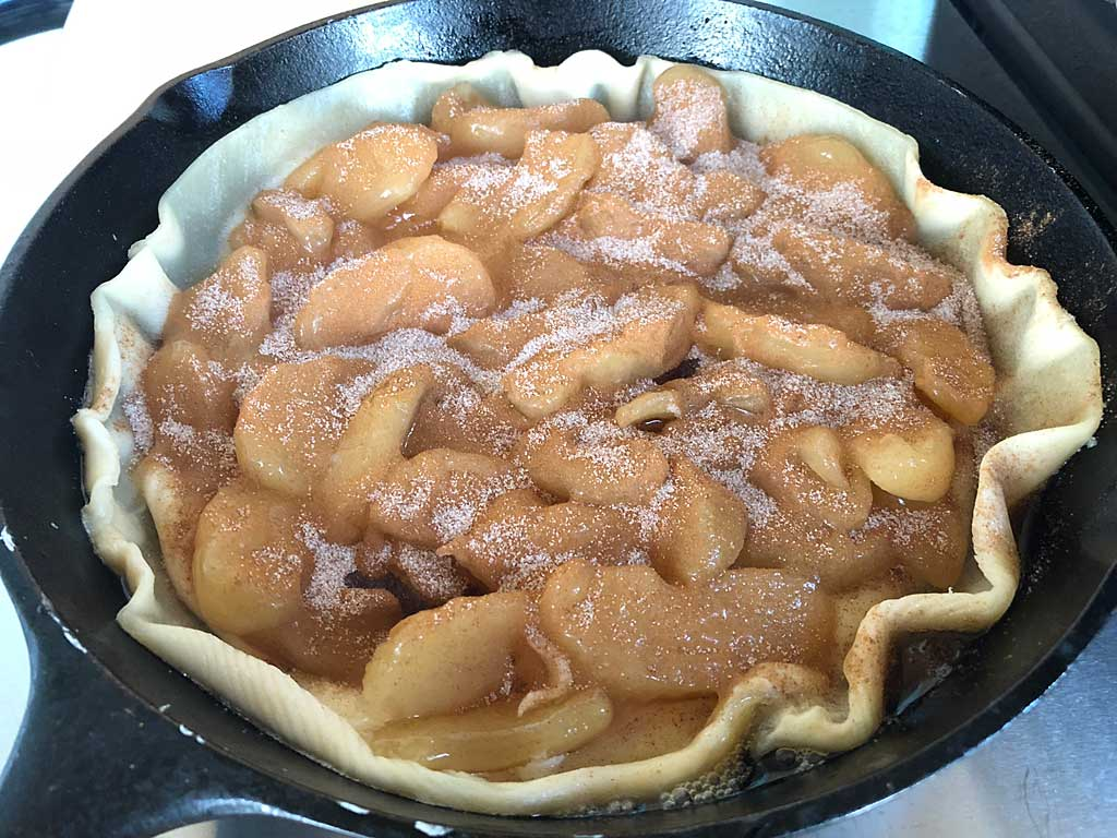 Apple pie filling and cinnamon sugar added to crust