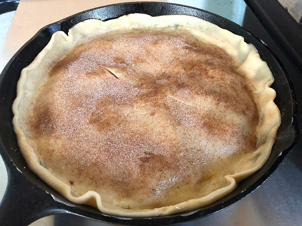 Second pie crust place onto pie and sprinkled with cinnamon sugar