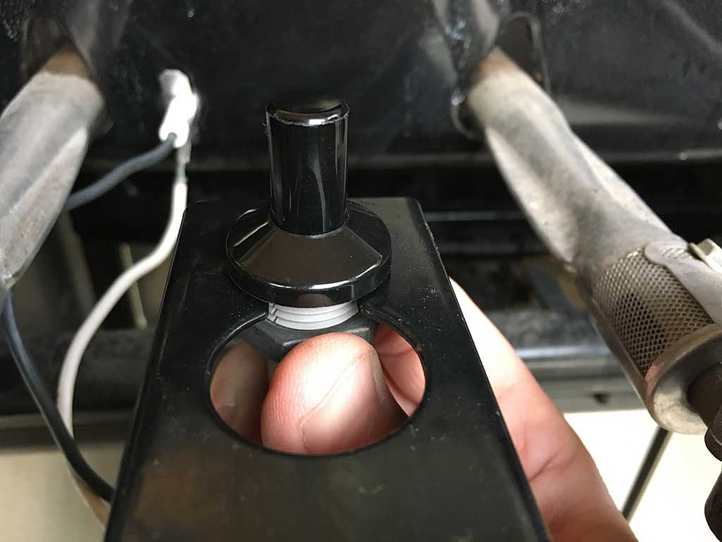 Mount the button and tighten the nut