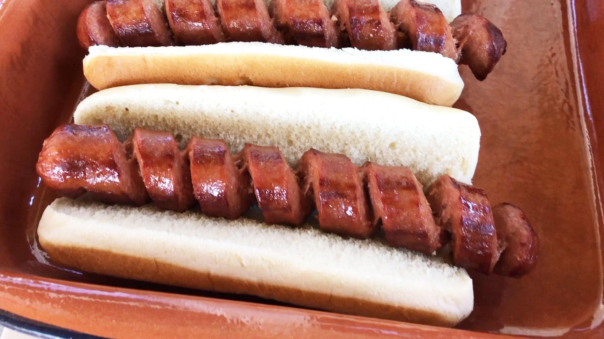 Spiral-sliced hot dog in bun