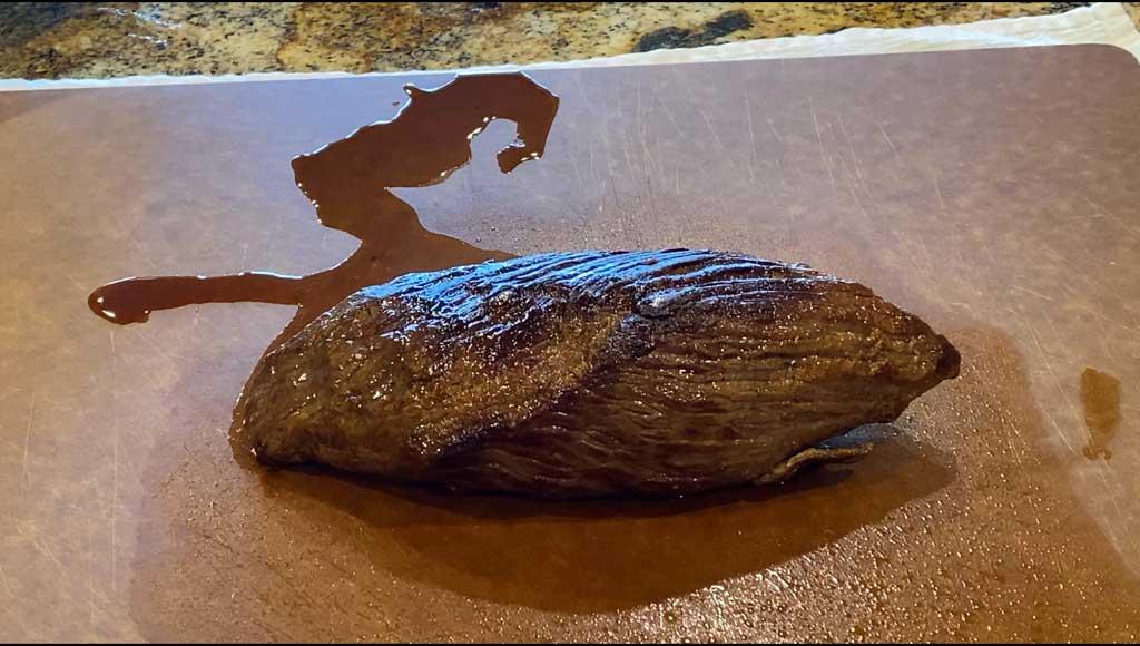 Grilled, unsliced teres major steak