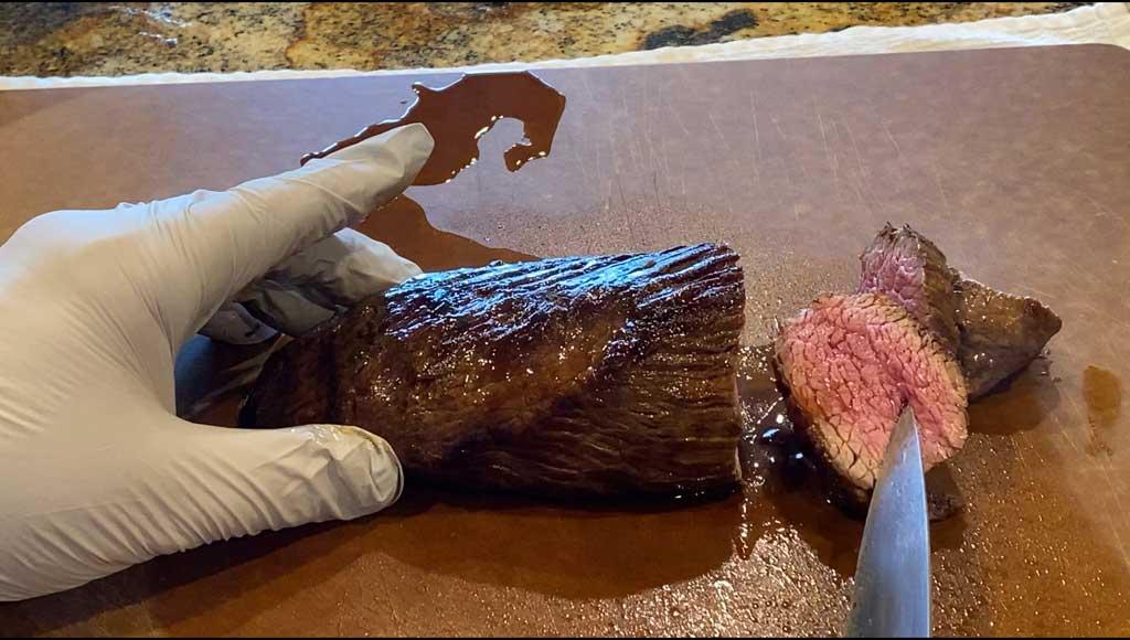 Slicing teres major steak