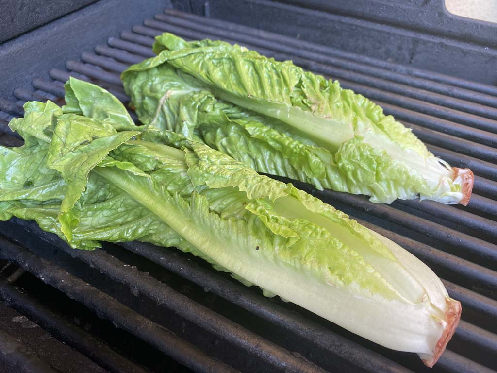 Romaine lettuce cut-side down on cooing grate
